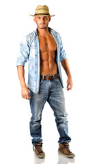 Handsome young man in jeans with straw hat