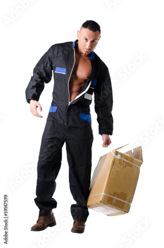 Muscular manual worker with open coveralls