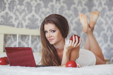 Sexy Girl Lying In Front Of Laptop