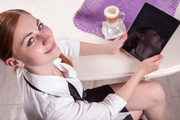 Young Businesswoman holding and working with tablet