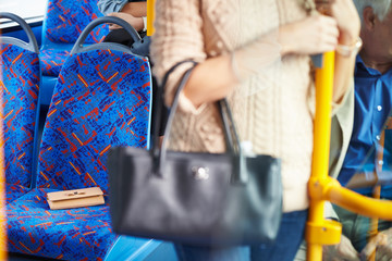 Passenger Leaving Change Purse On Seat Of Bus