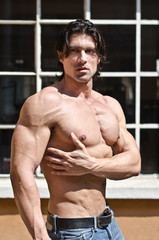 Attractive shirtless muscular man outdoors