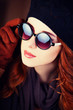 Style redhead women in sunglasses.