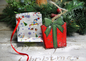 Beautiful toy wooden present box and Christmas wreath