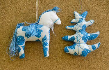 Handmade soft toy isolated New Year tree and horse