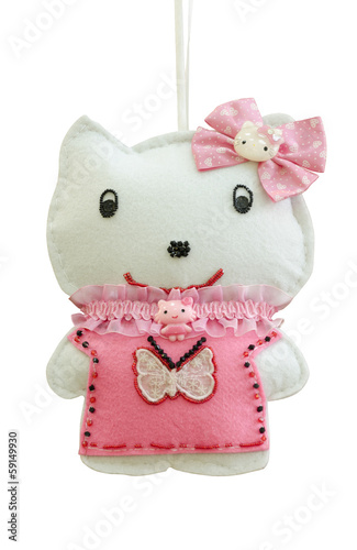 Handmade soft toy isolated happy kitty on a ribbon