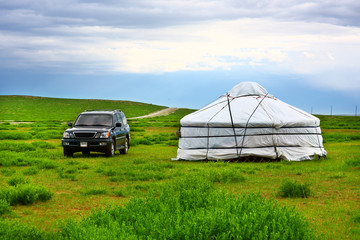 Jeep parked next to yurt