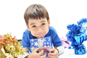 Little boy happy with new year gift