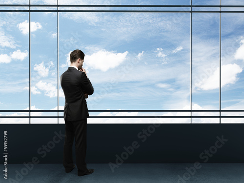 businessman looking to sky