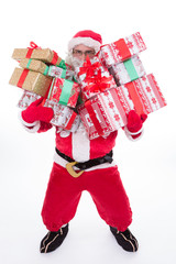 Santa Claus carrying gifts isolated on white background