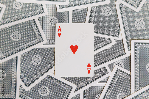 background of cards with red heart of ace on the top