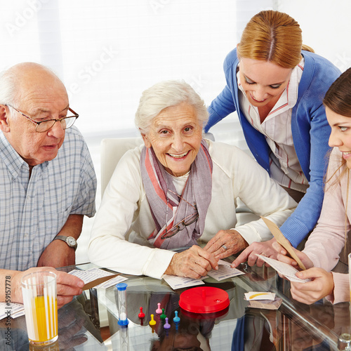 Family with senior couple playing games