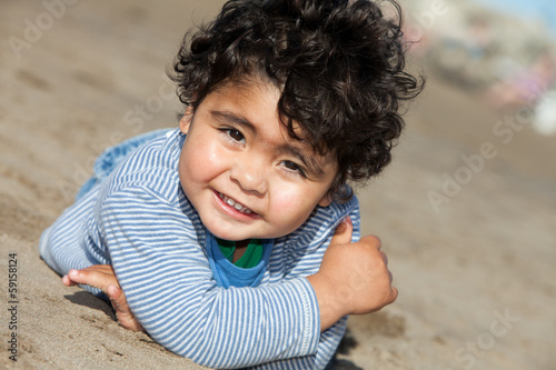 happy toddler at the beach
