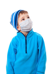 Boy in winter clothes and medical mask