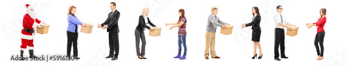 Full length portrait of different people collaborating each othe