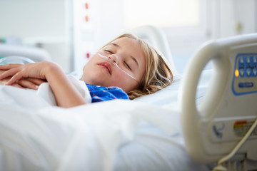 Young Girl Sleeping In Intensive Care Unit