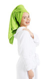 Beautiful woman in turban and bathrobe.