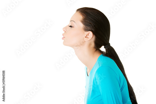 beautiful casual woman sending a kiss.
