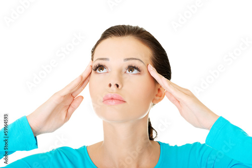 beautiful casual woman touching her temples.