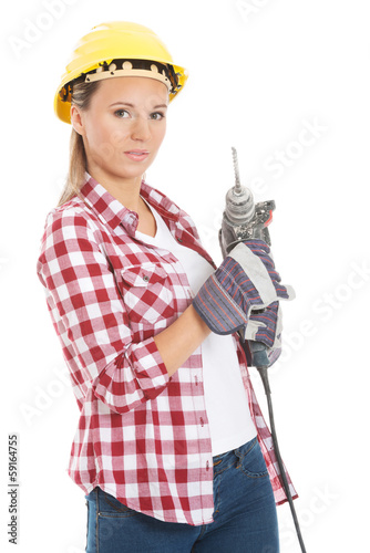 Young casual woman holding drill and wearing safety helmet.