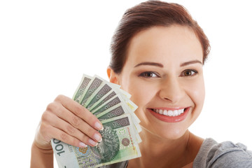Beautiful casual woman holding money.