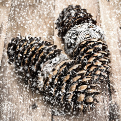 Vintage Christmas pine cone on wooden board with decorations and