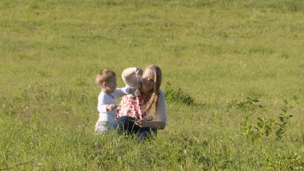 Mother and son on green grass.