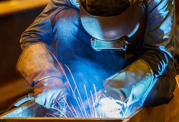 MIG welder in a factory