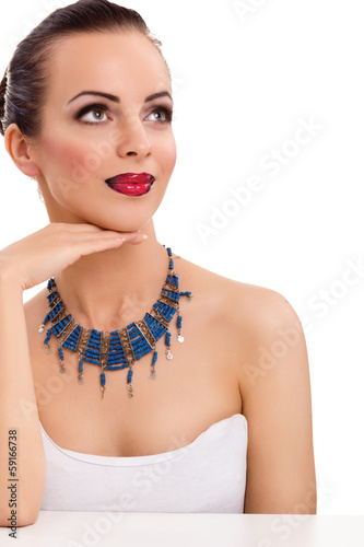 beautiful woman wearing blue necklace