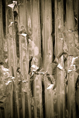 Galvanized corrugated iron in dark light background