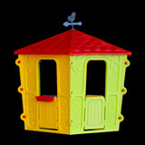 Isolated plastic children's playhouse