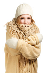 Smiling woman in warm clothing hugging herself