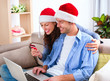 Christmas E-Shopping. Couple Using Credit Card to Internet Shop