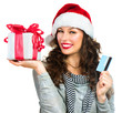 Christmas Shopping. Happy Smiling Woman with Gift Box