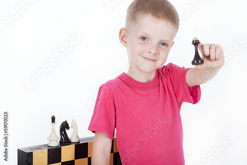 Happy boy with chessboard isolated on white background