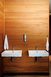 ceramic washbasin on the wooden wall