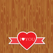 Vintege Valentine heart on wooden background