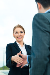 People welcoming with business handshake
