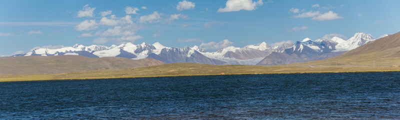 Panorama of alpine lake in TIen Shan mountains
