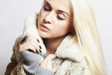 Beautiful blond woman in fur.winter fashion.Mink Fur Coat