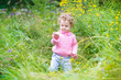 Cute funny baby girl playing in the garden