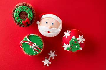 Christmas theme cupcakes in traditional red green colors