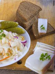 Marinated cabbage (sauerkraut), pickled cucumber,pieces of lard