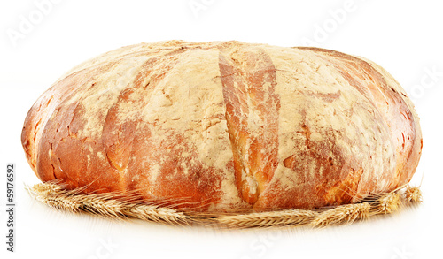 Large loaf of traditionally baked bread isolated on white