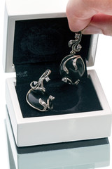 Silver earrings with black agate in a box