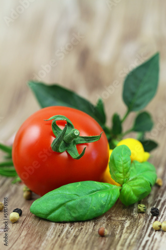 Cherry tomato with fresh basil and mixed peppers with copy space
