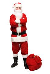 Happy traditional Santa Claus walking with bag. Christmas.