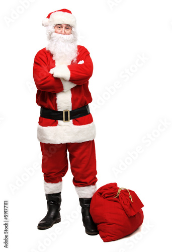 Happy traditional Santa Claus walking with bag. Christmas.