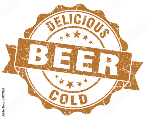 Delicious cold beer brown grunge textured retro seal on white