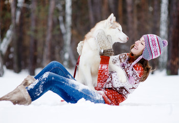 playful woman with dog